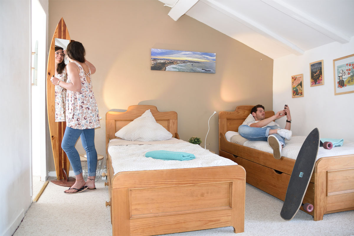 room with three single beds