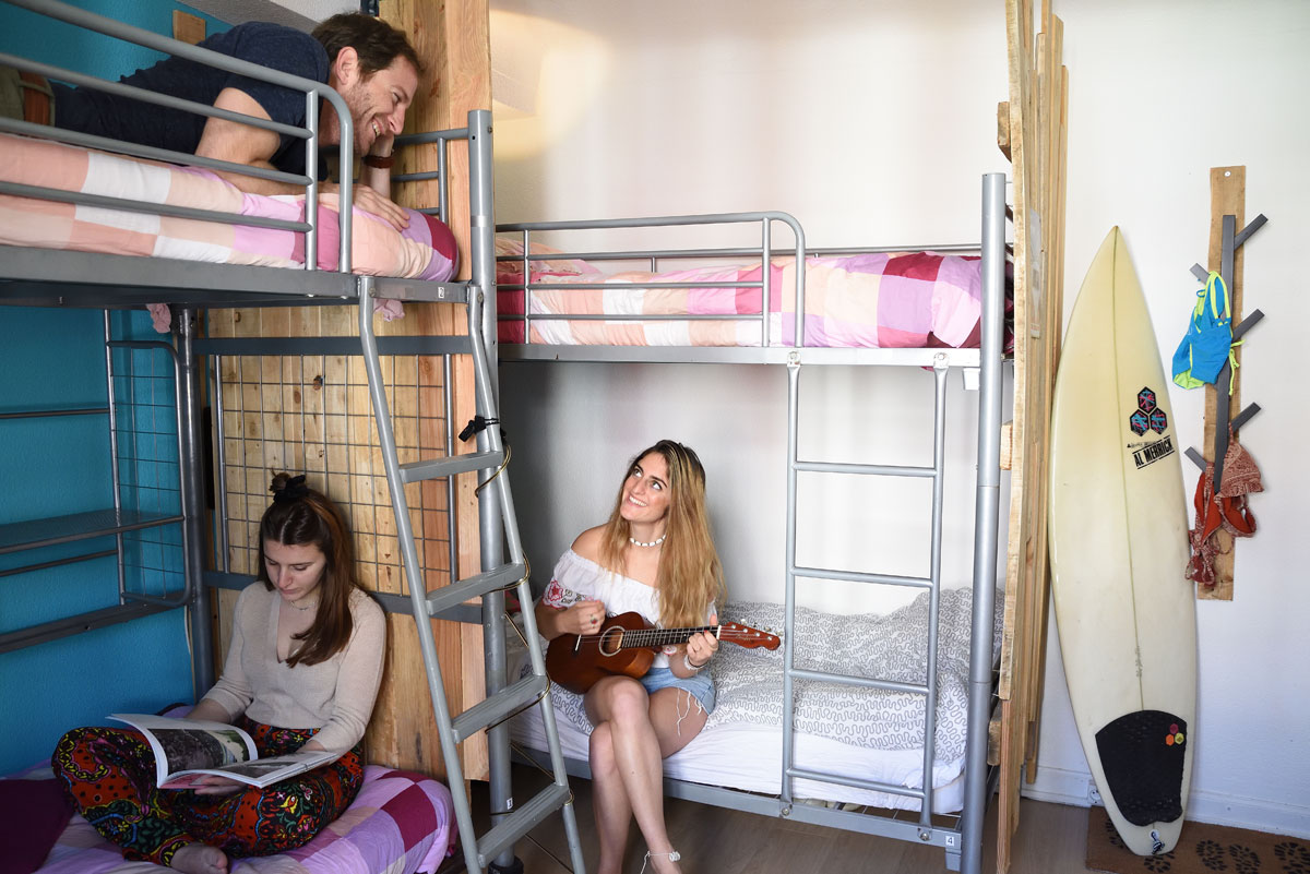 people in a room with two bunk beds
