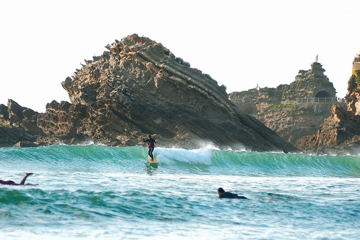 surfer on a wave at cote des basques